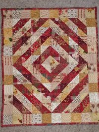 Doll_quilt_rust_and_gold
